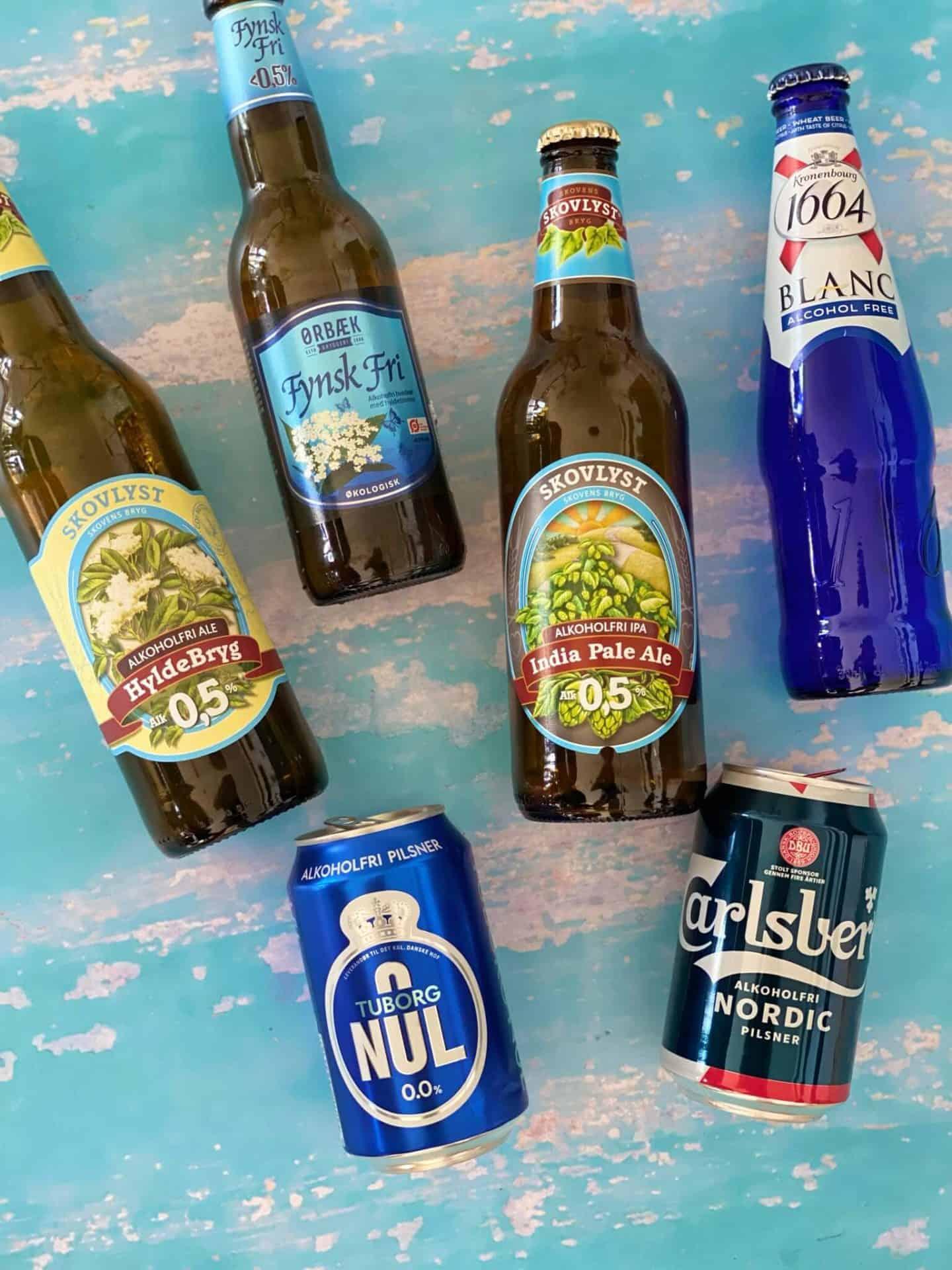 4 alkoholfrie ølflasker og 4 alkoholfrie øldåser